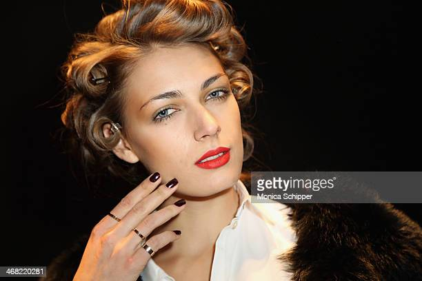 A model prepares backstage at the Georgine fashion show during MercedesBenz Fashion Week Fall 2014 at The Pavilion at Lincoln Center on February 9...