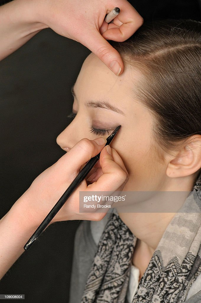 A model prepares backstage at the Jad Ghandour Fall 2011 fashion show during Mercedes-Benz Fashion Week at Exit Art on February 10, 2011 in New York City.