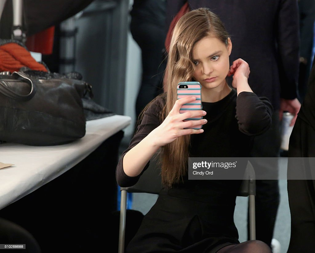 A model prepares backstage at the Jenny Packham Fall 2016 fashion show during New York Fashion Week: The Shows at The Gallery, Skylight at Clarkson Sq on February 14, 2016 in New York City.