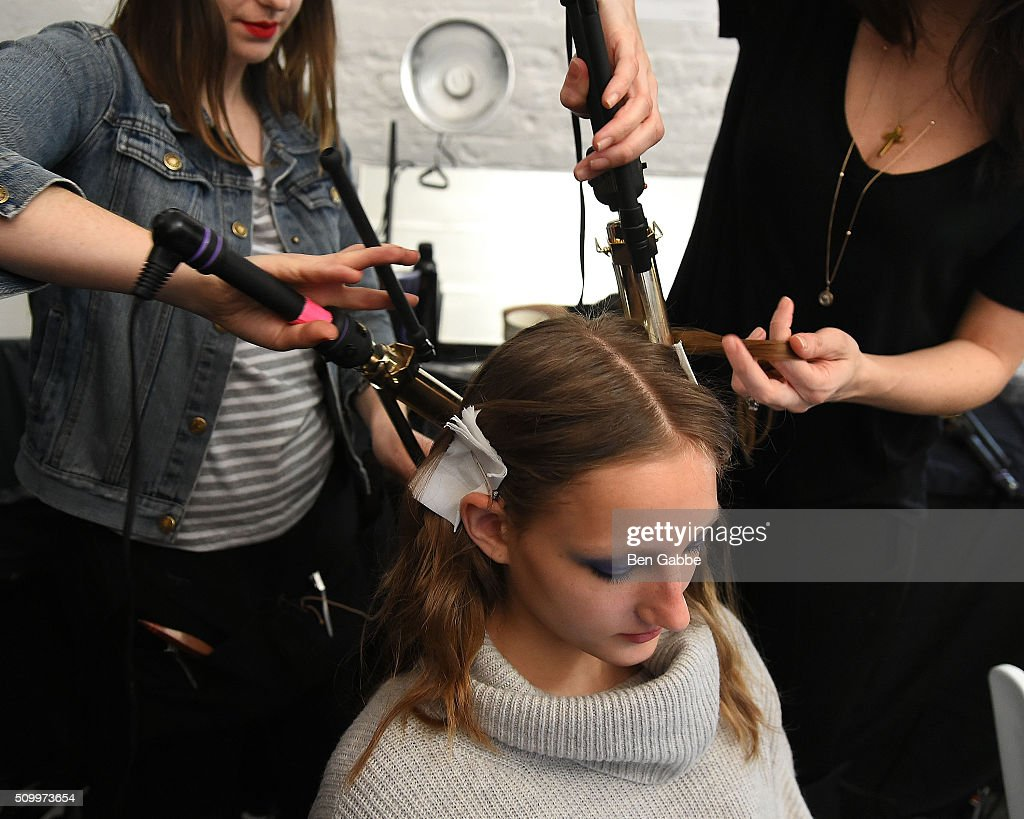A model prepares backstage at the Jill Stuart fashion show during Fall 2016 New York Fashion Week at Industria Superstudio on February 13, 2016 in New York City.