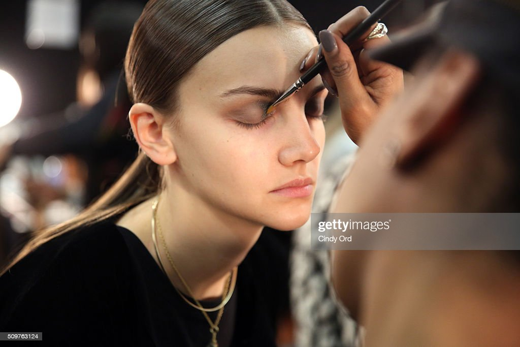 A model prepares backstage at the Karigam Fall 2016 fashion show during New York Fashion Week: The Shows at The Space, Skylight at Clarkson Sq on February 12, 2016 in New York City.