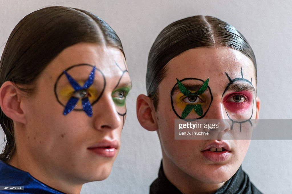 A model prepares backstage at the Katie Eary show at the London Collections Men AW15 at Victoria House on January 12 2015 in London England