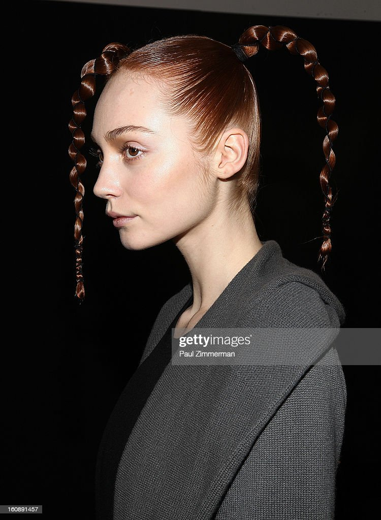 A model prepares backstage at the Kimberly Ovitz during Fall 2013 Mercedes-Benz Fashion Week>> at Cafe Rouge on February 7, 2013 in New York City.