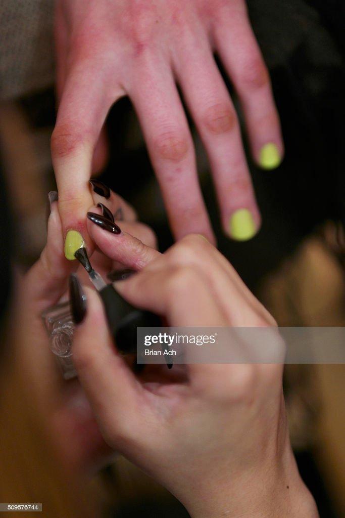 A model prepares backstage at the Kye Fall 2016 fashion show during New York Fashion Week: The Shows at The Gallery, Skylight at Clarkson Square on February 11, 2016 in New York City.