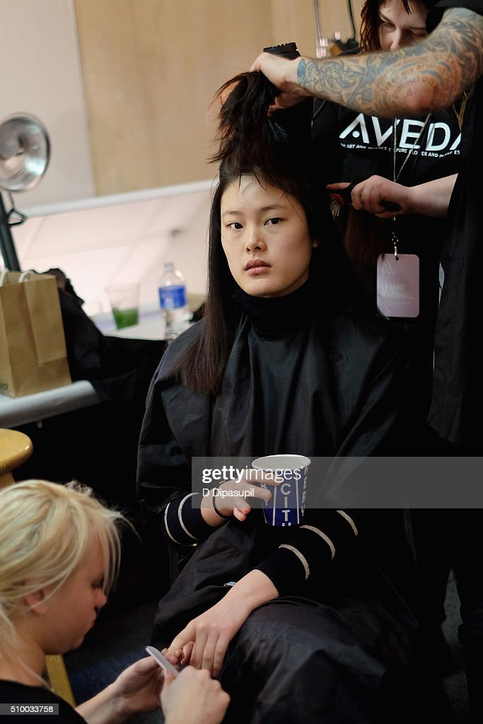 A model prepares backstage at the Leanne Marshall Fall 2016 fashion show during New York Fashion Week: The Shows at The Gallery, Skylight at Clarkson Sq on February 13, 2016 in New York City.