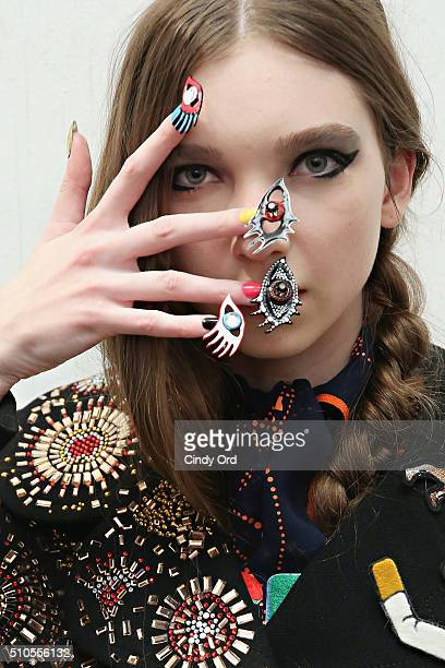 A model prepares backstage at the Libertine Fall 2016 fashion show during New York Fashion Week The Shows at The Gallery Skylight at Clarkson Sq on...