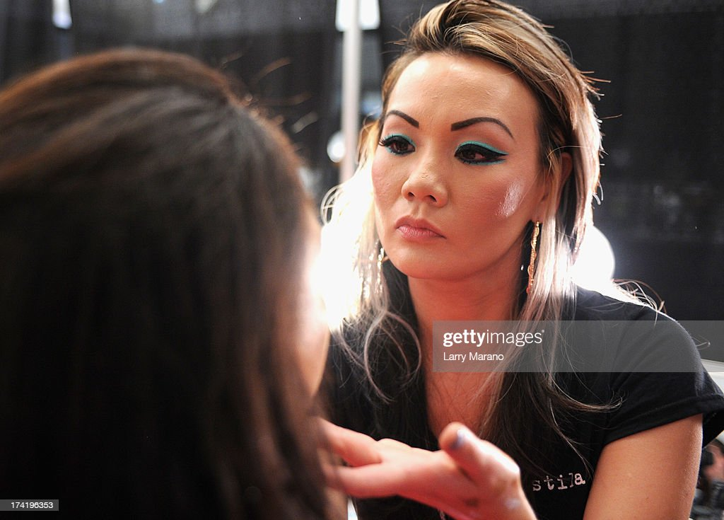 A model prepares backstage at the L*Space By Monica Wise show during Mercedes-Benz Fashion Week Swim 2014 at Cabana Grande at the Raleigh on July 21, 2013 in Miami, Florida.