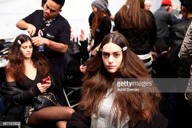 A model prepares backstage at the Marissa Webb fashion show with TRESemme during MercedesBenz Fashion Week Fall 2014 at The Salon at Lincoln Center...