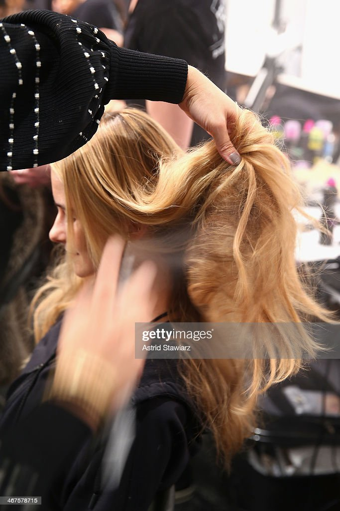 A model prepares backstage at the Marissa Webb fashion show with TRESemme during Mercedes-Benz Fashion Week Fall 2014 at The Salon at Lincoln Center on February 6, 2014 in New York City.
