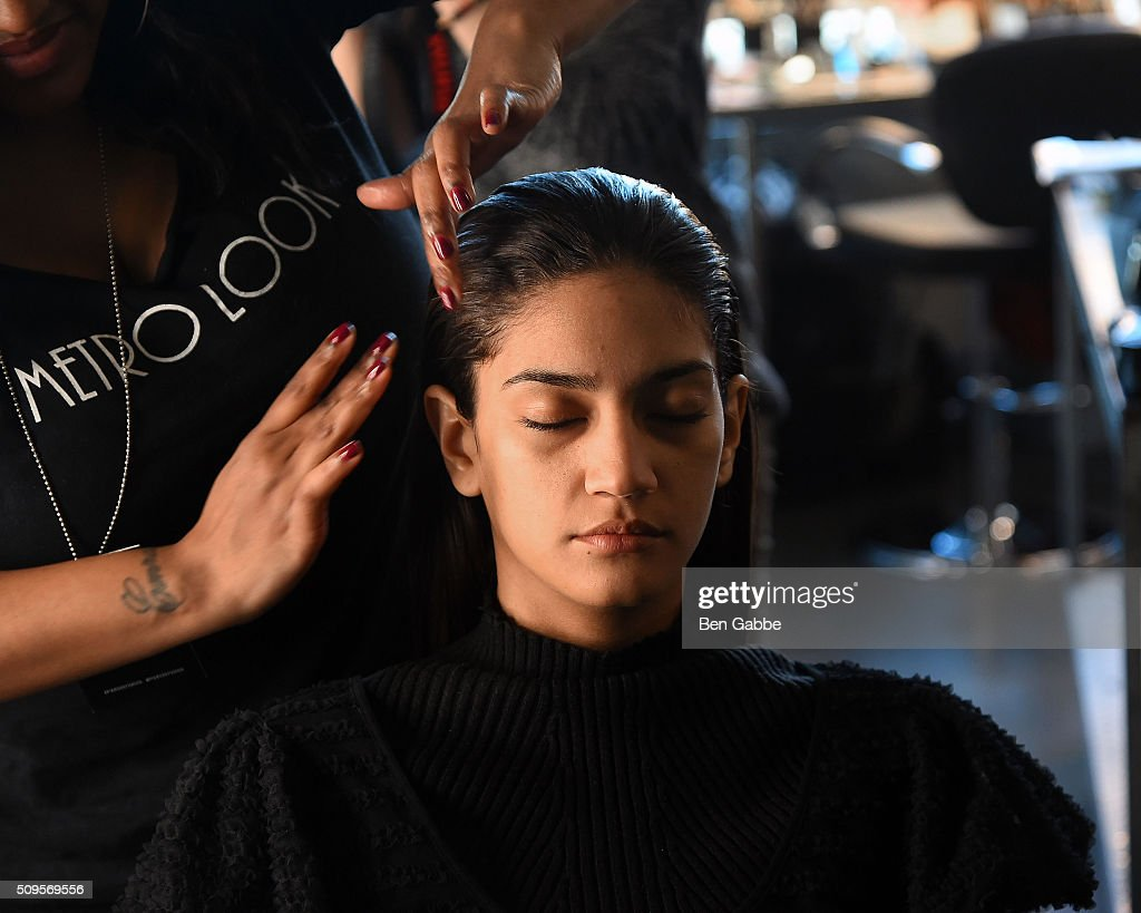 A model prepares backstage at the Mathieu Mirano presentation during Fall 2016 New York Fashion Week at Pier 59 Studios on February 11, 2016 in New York City.