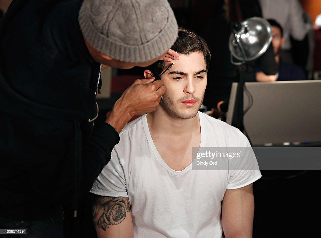 A model prepares backstage at the Michael Bastian fall 2014 fashion show at Rubin Museum of Art on February 4, 2014 in New York City.