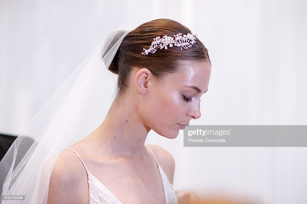A model prepares backstage at the Monique Lhuillier Bridal Spring/Summer 2016 Runway Show at the Baccarat Hotel on April 17 2015 in New York City