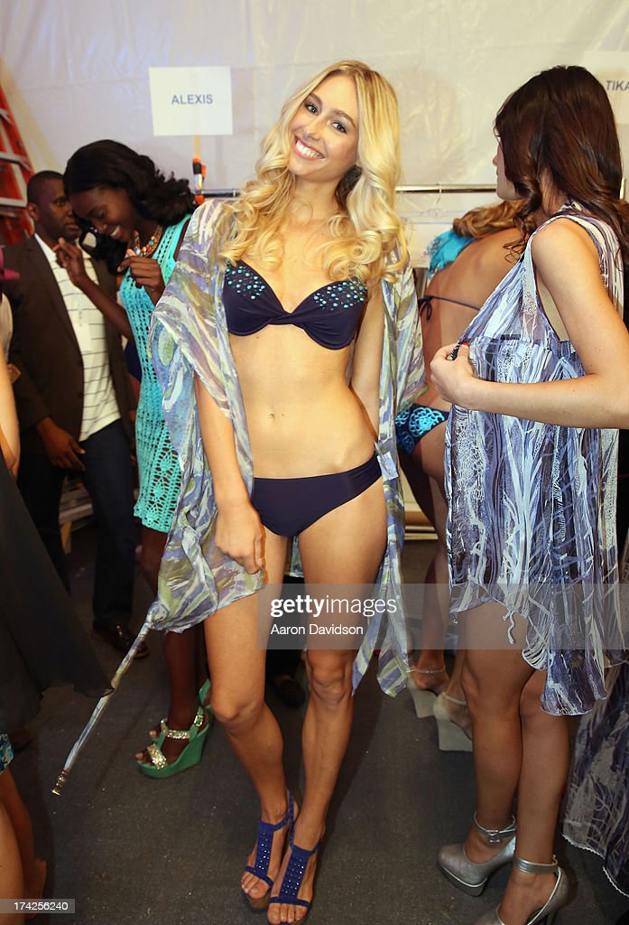 A model prepares backstage at the Naila/ Sauvage/ Zingara Swimwear show At Mercedes-Benz Fashion Week Swim 2014 at Cabana Grande at the Raleigh on July 22, 2013 in Miami, Florida.
