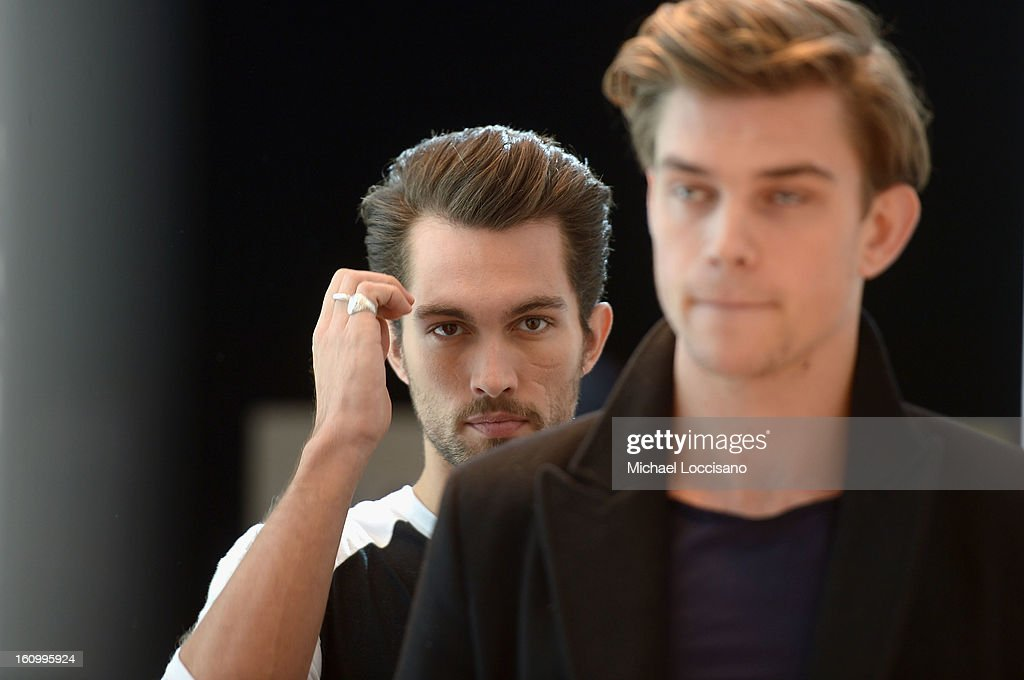 A model prepares backstage at the Nautica Men's Fall 2013 fashion show during Mercedes-Benz Fashion Week at The Stage at Lincoln Center on February 8, 2013 in New York City.