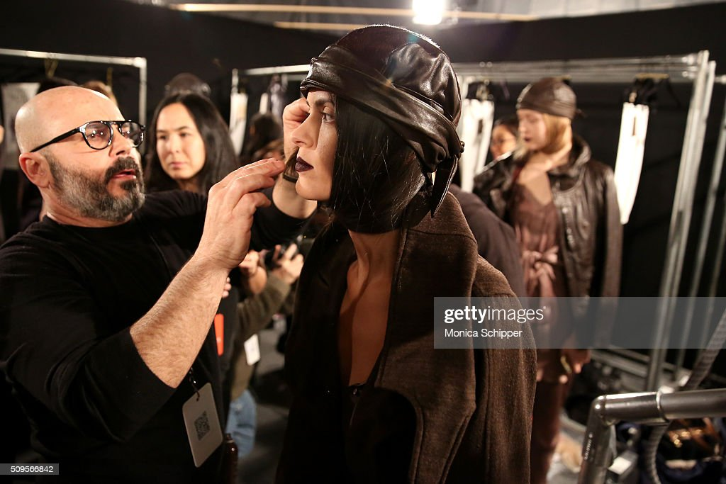A model prepares backstage at the Nicholas K Fall 2016 fashion show during New York Fashion Week: The Shows at The Dock, Skylight at Moynihan Station on February 11, 2016 in New York City.