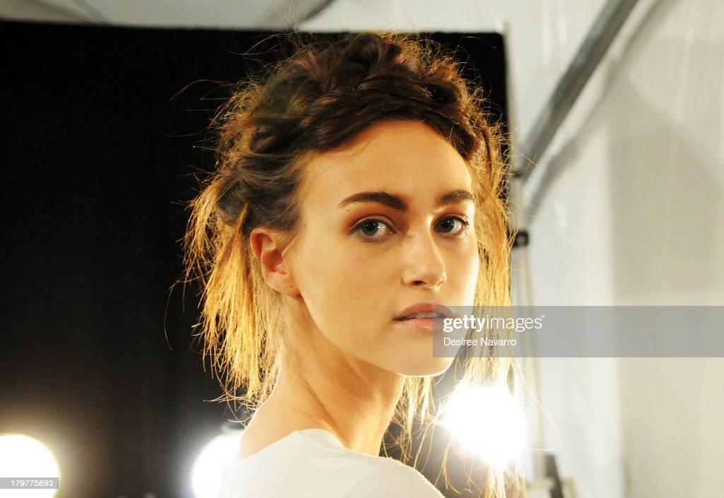 A model prepares backstage at the Nicole Miller show during Spring 2014 Mercedes-Benz Fashion Week at The Studio at Lincoln Center on September 6, 2013 in New York City.