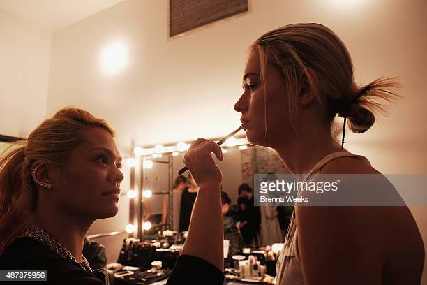 A model prepares backstage at the Osklen presentation during Spring 2016 New York Fashion Week at Industria Studios on September 12 2015 in New York...
