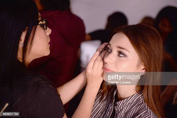 A model prepares backstage at the Pamella Roland fashion show during MercedesBenz Fashion Week Fall 2015 at The Pavilion at Lincoln Center on...