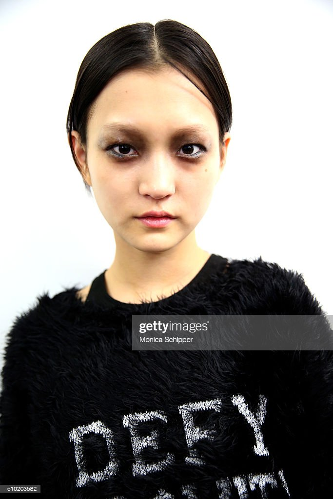 A model prepares backstage at the Public School Fall 2016 fashion show during New York Fashion Week on February 14, 2016 in New York City.