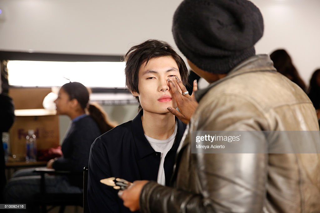 A model prepares backstage at the Pyer Moss Fall 2016 fashion show during MADE Fashion Week at Milk Studios on February 13, 2016 in New York City.