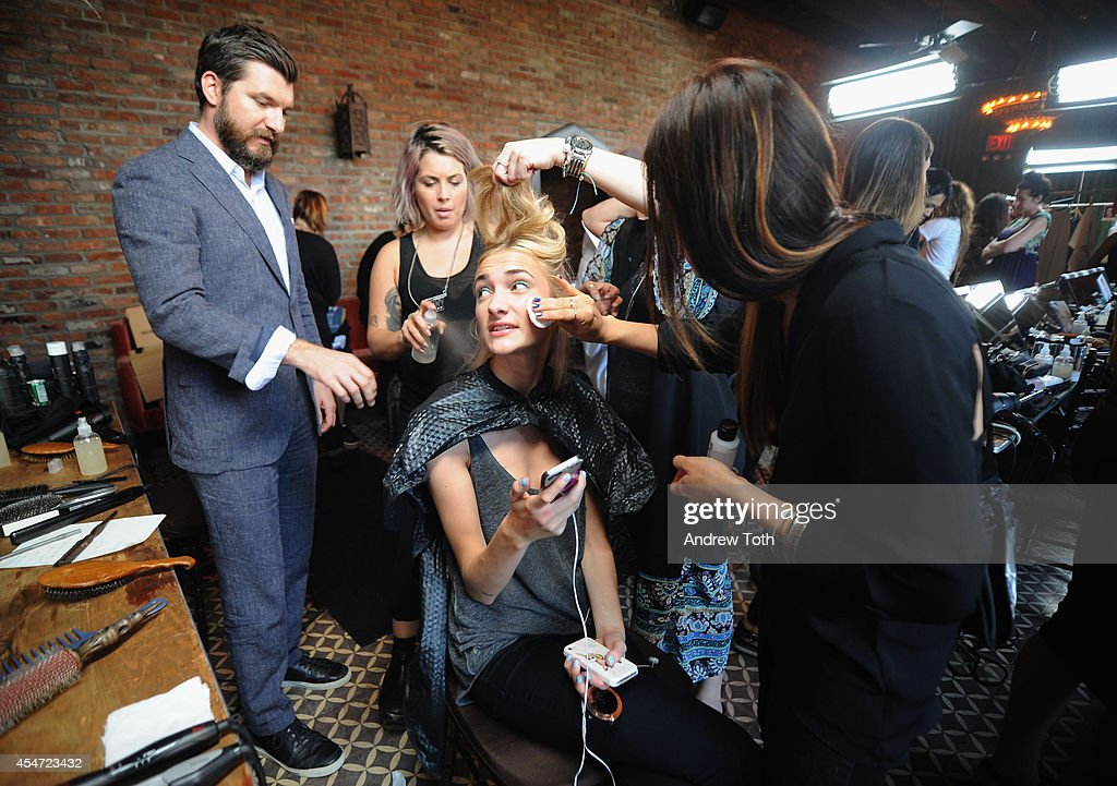 A model prepares backstage at the Rodebjer fashion show during MercedesBenz Fashion Week Spring 2015 at The Bowery Hotel on September 5 2014 in New...