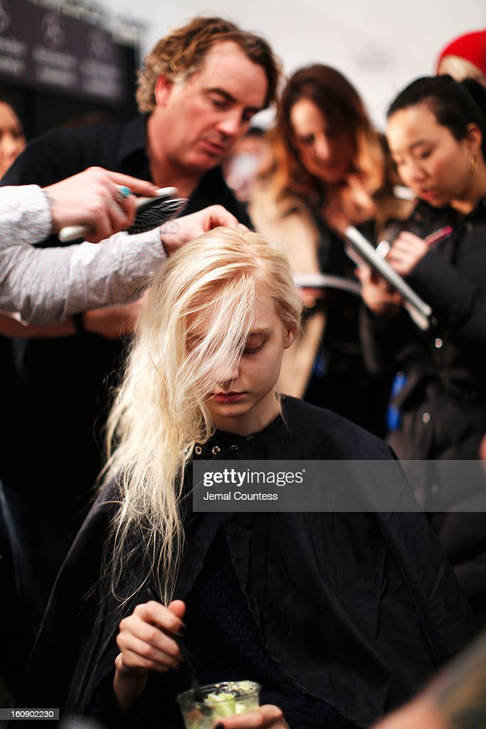 A model prepares backstage at the Tadashi Shoji Fall 2013 fashion show during Mercedes-Benz Fashion Week at The Stage at Lincoln Center on February 7, 2013 in New York City.
