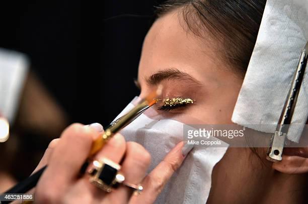 A model prepares backstage at the Tadashi Shoji fashion show during MercedesBenz Fashion Week Fall 2015 at The Salon at Lincoln Center on February 12...