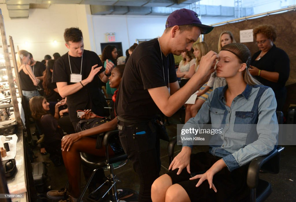 A model prepares backstage at the Tanya Taylor fashion show during Mercedes-Benz Fashion Week Spring 2014 at Industria Studios on September 5, 2013 in New York City.