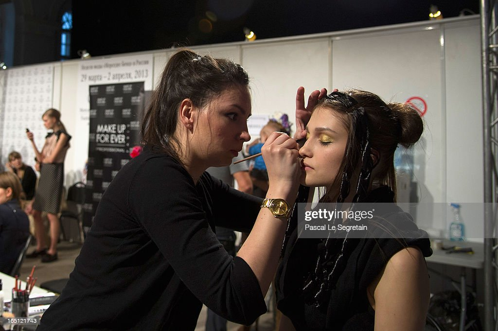 A model prepares backstage at the Tatyana Parfionova show during Mercedes-Benz Fashion Week Russia Fall/Winter 2013/2014 at Manege on March 31, 2013 in Moscow, Russia.