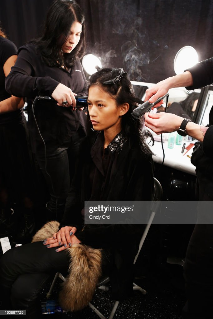 A model prepares backstage at the Timo Weiland Women's Fall 2013 fashion show during Mercedes-Benz Fashion Week at The Studio at Lincoln Center on February 7, 2013 in New York City.
