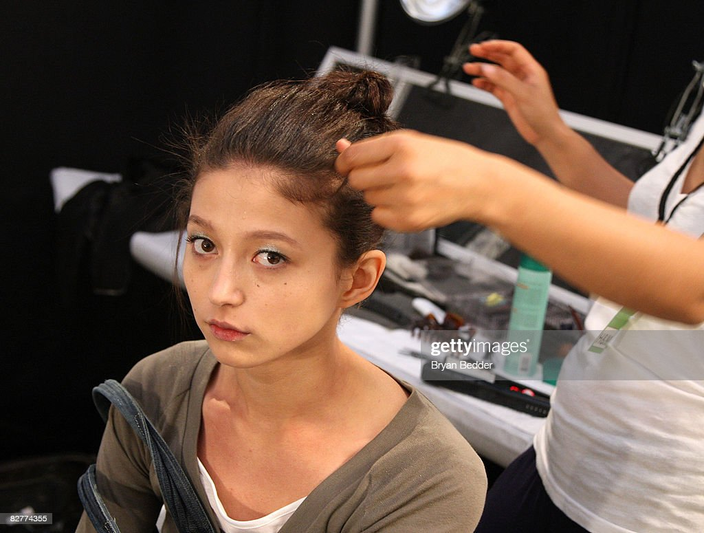 A model prepares backstage at the Vera Wang Spring 2009 fashion show during Mercedes-Benz Fashion Week at The Tent, Bryant Park on September 11, 2008 in New York City.