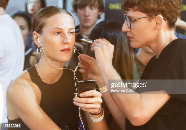 A model prepares backstage at the Victor Dzenk fashion show during Sao Paulo Fashion Week Winter 2015 at Parque Candido Portinari on November 3 2014...