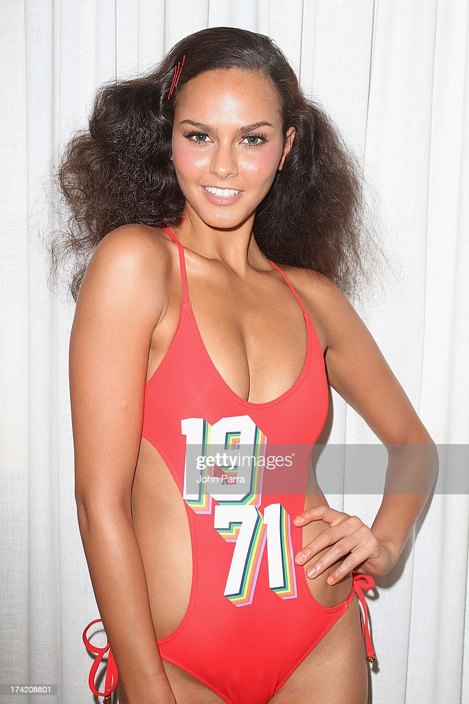 A model prepares backstage at the Wildfox Swim Cruise 2014 show at Soho Beach House on July 21, 2013 in Miami Beach, Florida.