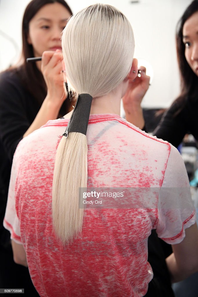 A model prepares backstage at the Yigal Azrouel Fall 2016 fashion show during New York Fashion Week: The Shows at The Gallery, Skylight at Clarkson Sq on February 12, 2016 in New York City.