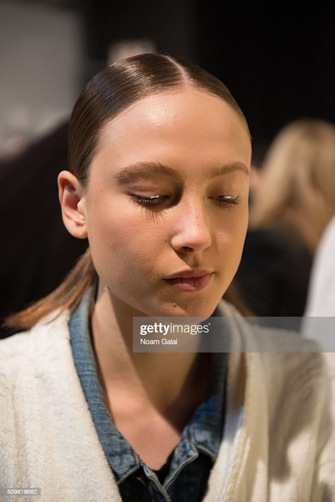 A model prepares backstage at the Zimmermann fashion show during Fall 2016 New York Fashion Week at Art Beam on February 12, 2016 in New York City.