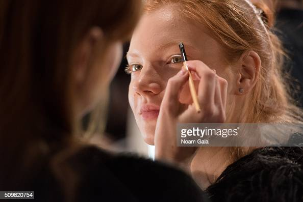A model prepares backstage at the Zimmermann fashion show during Fall 2016 New York Fashion Week at Art Beam on February 12 2016 in New York City