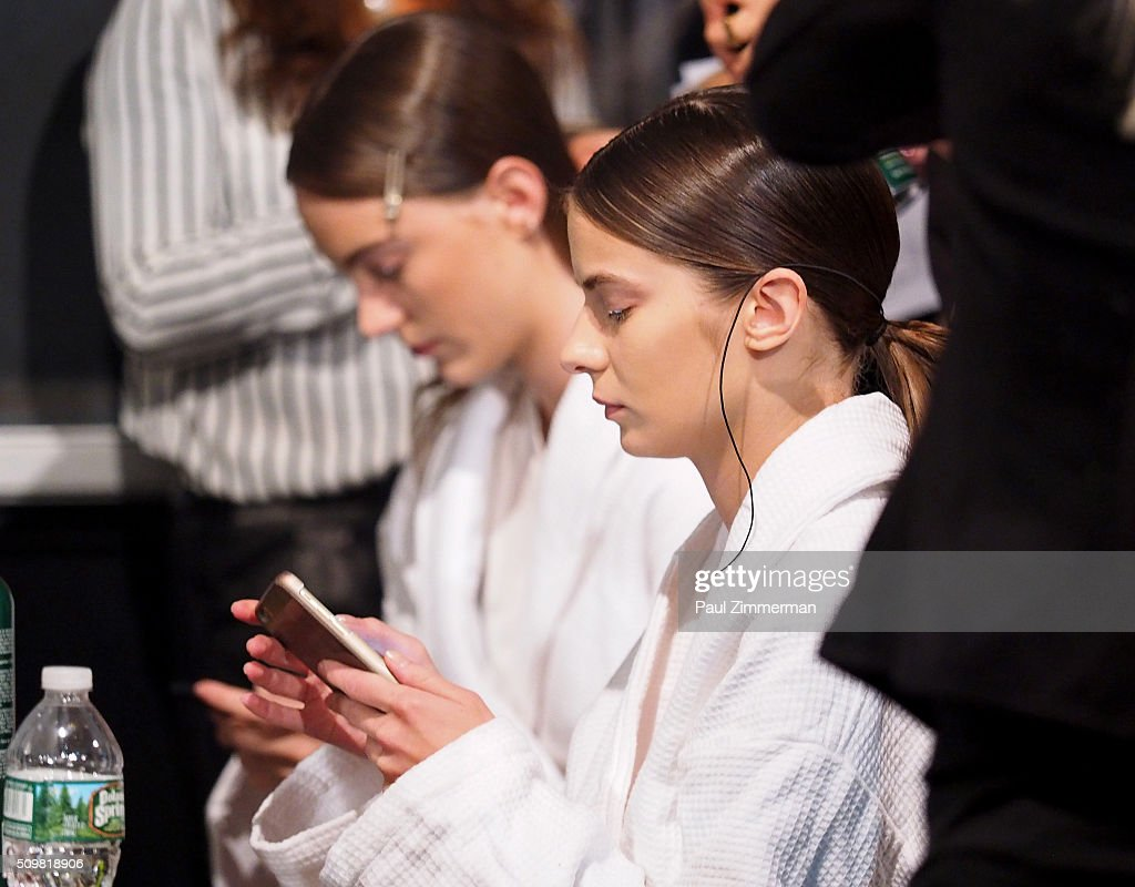 A model prepares backstage at the Zimmermann - Front Row & Backstage - Fall 2016 New York Fashion Week at ArtBeam on February 12, 2016 in New York City.