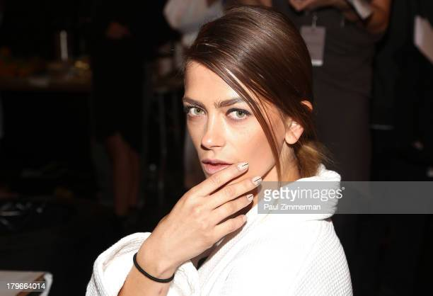 A model prepares backstage at the Zimmermann show during Spring 2014 MercedesBenz Fashion Week at The Studio at Lincoln Center on September 6 2013 in...