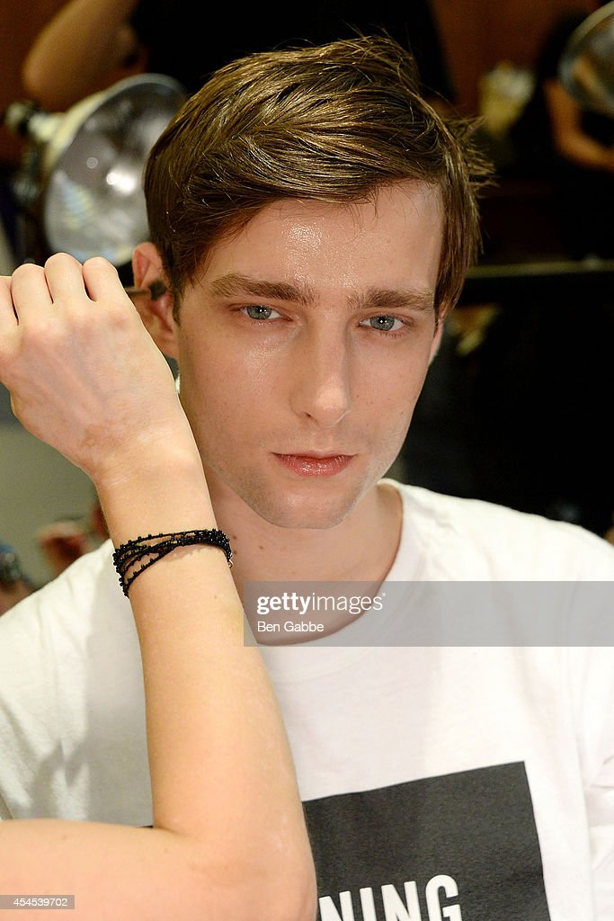 A model prepares backstage at Timo Weiland Men's during Mercedes-Benz Fashion Week Spring 2015 at The Highline Hotel on September 3, 2014 in New York City.