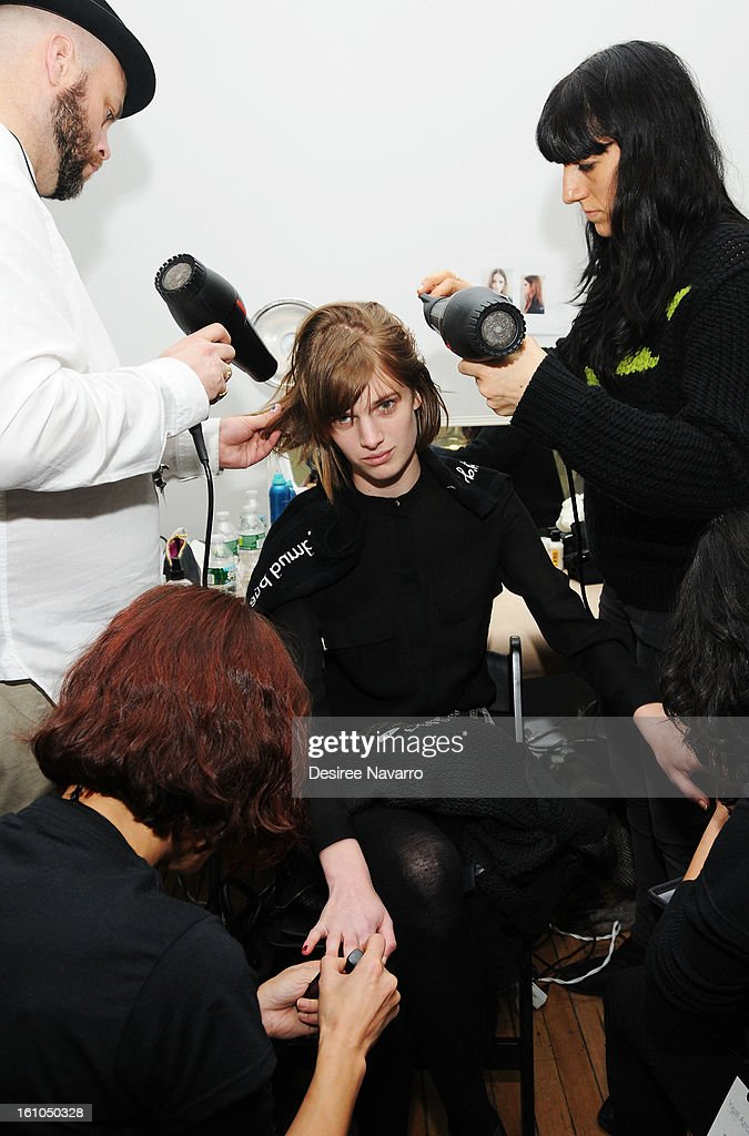 A model prepares backstage at Yigal Azrouel during Fall 2013 Mercedes-Benz Fashion Week at Highline Stages on February 8, 2013 in New York City.