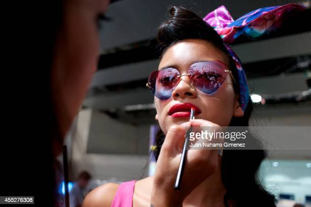 Model prepares backstage before a fashion show of Desigual during the Mercedes Benz Fashion Week Madrid S/S 2015 at Ifema on September 11 2014 in...