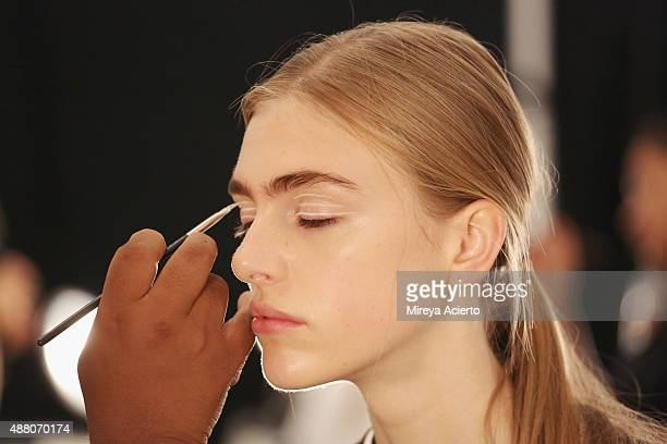 A model prepares backstage before Public School fashion show during Spring 2016 New York Fashion Week The Shows at The Arc Skylight at Moynihan...
