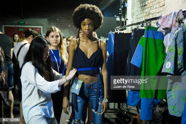 A model prepares backstage before the 22/4_Hommes Menswear Spring/Summer 2018 show as part of Paris Fashion Week on June 23 2017 in Paris France