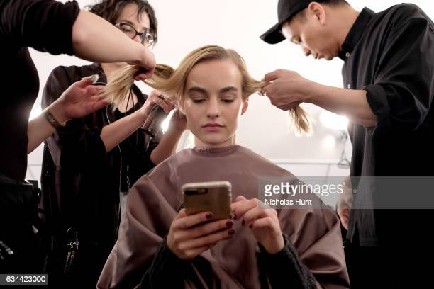 A model prepares backstage before the Brock Collection during New York Fashion Week Presented By MADE at Gallery 2 Skylight Clarkson Sq on February 9...