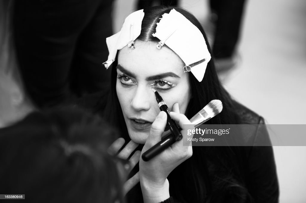 A model prepares backstage before the Chanel Fall/Winter 2013/14 Ready-to-Wear show as part of Paris Fashion Week at Grand Palais on March 5, 2013 in Paris, France.