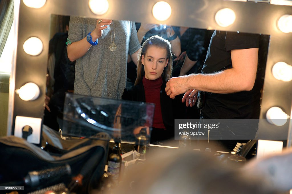 A model prepares backstage before the Collette Dinnigan 2013/14 Ready-to-Wear show as part of Paris Fashion Week at Le Meurice on March 3, 2013 in Paris, France.