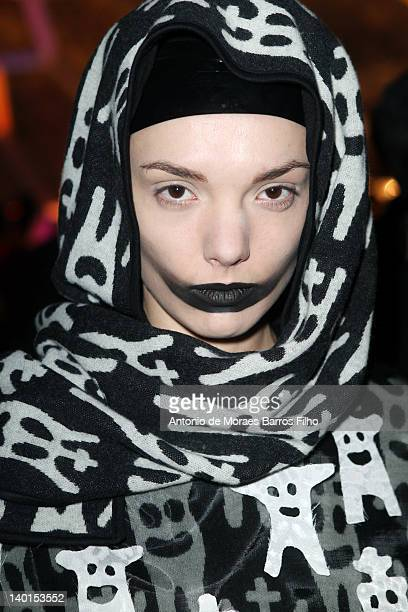 A model prepares backstage before the Devastee ReadyToWear Fall/Winter 2012 show as part of Paris Fashion Week at Le Showcase on February 29 2012 in...