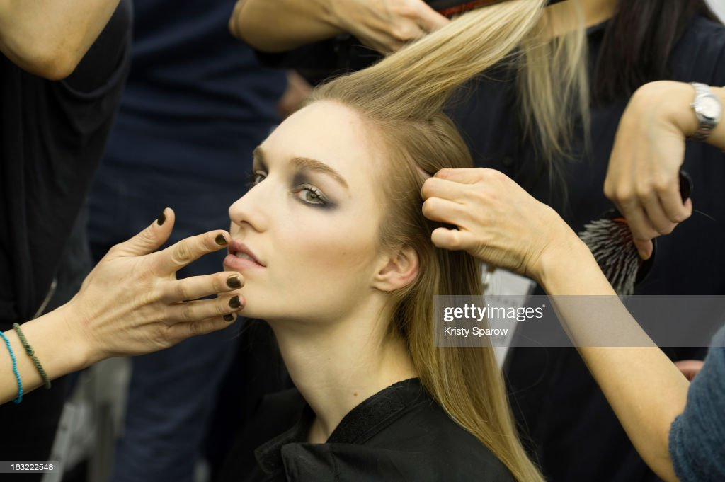 A model prepares backstage before the Elie Saab Fall/Winter 2013/14 Ready-to-Wear show as part of Paris Fashion Week on March 6, 2013 in Paris, France.