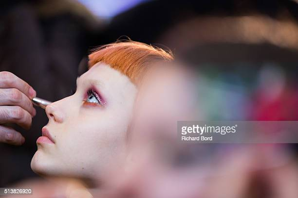 A model prepares backstage before the Emanuel Ungaro show as part of the Paris Fashion Week Womenswear Fall/Winter 2016/2017 on March 4 2016 in Paris...