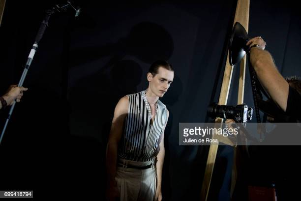 A model prepares backstage before the Haider Ackermann Menswear Spring/Summer 2018 show as part of Paris Fashion Week on June 21 2017 in Paris France